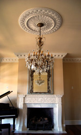 Our MT1004 Stone Mantel featured with M10-48 Medallion & DM730 Crown Molding