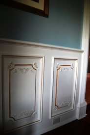 Cast plaster panels installed vertically as wainscoting (center detail removed)
