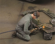 Royal Model - Man using Electric Welder, Kneeling