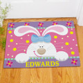 Personalized Easter Bunny doormat in pastel colors.