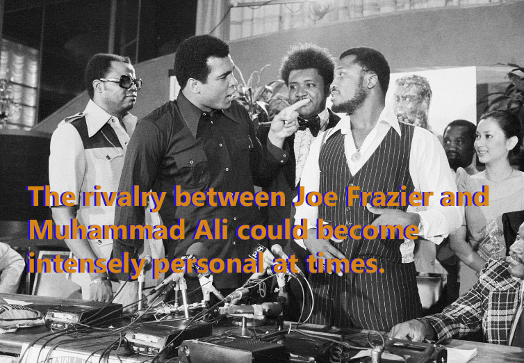 Muhammad Ali and Joe Frazier face off in a press conference