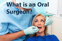THIS IS A PICTURE OF AN ORAL SURGEON WITH A PATIENT
