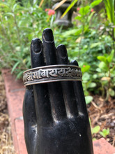 White Metal Spiral Mantra Bracelet Sanskrit