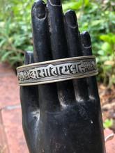 White Metal Curly Mantra Bracelet Sanskrit