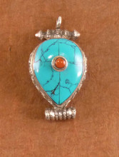 Silver Gau with Turquoise and red stone.