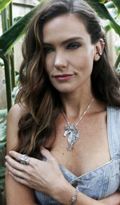 Danielle is wearing the Good Luck Horseshoe Ear Cuff Combo in bronze and silver, Spirit Horse Pendant, Quiver and Arrow Link Bracelet, and Eagle Ring all in silver.