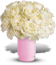 If she enjoys being a girl, this enchanting bouquet will win her heart all over again. Fabulously feminine, it delivers snowy white roses and white carnations in a classic frosted pink hurricane vase. She'll absolutely adore it!