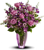 This gorgeous bouquet, aptly named for its light and delicately arranged blooms, features the most luscious lavender roses imaginable. Artistically arranged in a pale lavender vase, the mix of flowers is breathtaking.  Vase may vary but will be a High End Vase.