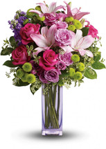 Color them happy with this bold, beautiful mix of hot pinks, flirty lavenders, and lime greens! Hand-delivered in a lavender glass vase, this posh present pampers your loved one on a special day - or any day at all!