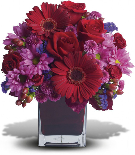 The only crying that this plum party arrangement might inspire are tears of joy! So fabulous. So fun. So fall with its jewel-toned modern cube that's chock full of gorgeous red, purple and perfect flowers.