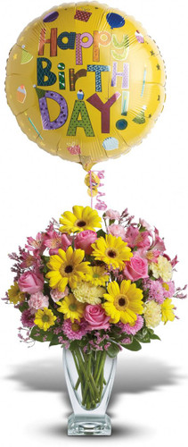 Dazzle someone on their special day with a balloon-festooned bouquet. Delightful blossoms and a shiny birthday balloon are sure to make their day! Actual vase may very.