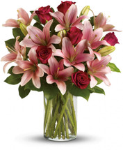 Turn an ordinary day into an enchanting daydream by sending her this magical bouquet! This stunning bouquet of rich red roses and magnificent pink lilies pampers her senses, refreshes her spirit and shows her how much you really care.