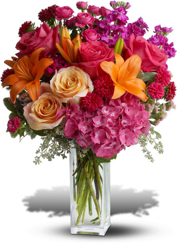Wow! That's what they'll say when this explosion of color arrives at the front door. They'll love the flowers, the clear glass vase - and you for having such exciting taste. A win-win for everybody!