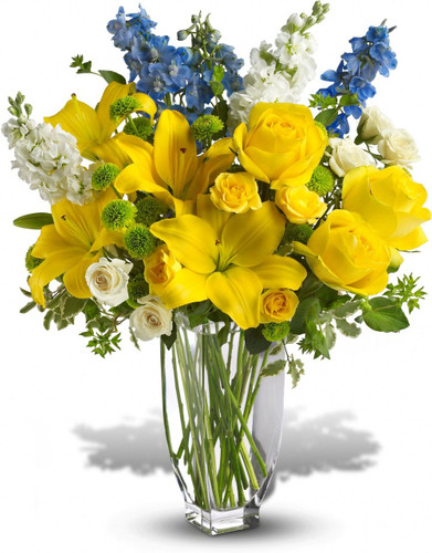 With a beauty reminiscent of the south of France, this proud and pretty arrangement holds nothing back. The colors, the flowers and the feeling of Provence are all present and accounted for in this wonderful bouquet.