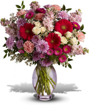 A perfectly pleasing mix of sweet springtime blossoms make this a truly happy gift. So full of feminine flowers and fun feelings, this is the perfect arrangement to make her smile.