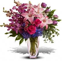 This arrangement is perfect for anyone who's passionate about purple. So full of majestic beauty, it will deliver any message with panache.  Actual flower types may vary with availability.