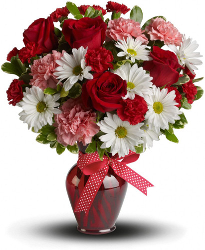 "Whether for your significant other or your sister, aunt or grandmother, this delightful floral gift is a sweet way to say ""I love you."" Sweet price, too."