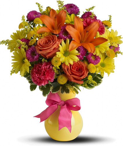 If there are any clouds on the horizon, they'll disappear fast when this burst of floral favorites arrives in a charming vase that's as yellow as sunshine. Perfect for get-well and just about everything else.