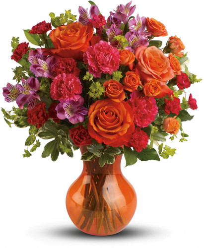 At once bold and delicate, this gorgeous gathering of pink and orange blooms is a fabulous way to fancy up her day.