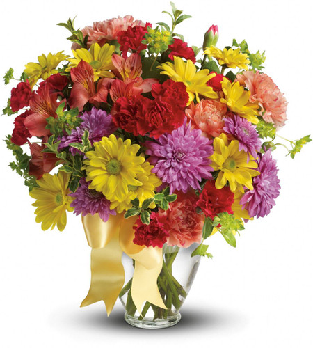 Color her overjoyed when this beautiful bouquet is delivered to her door! Sunny reds, oranges and yellows create a heartwarming mix to remind her just how special she is.