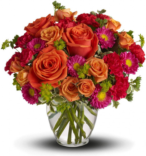 How sweet it will be when this dazzling arrangement arrives at someone's door. Very vibrant. Very vivacious. And very, very pretty.