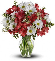 Happy birthday to you! Or happy anniversary! Or happy nothing special! Whatever the occasion (or non-occasion), this stunning array of the season's most fabulous flowers in a clear glass vase will make their day.