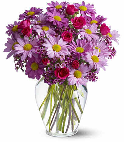 "A beautiful bouquet of luscious lavender, bright purple and hot pink delivers a message that is simply delightful.  Hot pink spray roses and waxflower are the just the ""bright"" accent for lavender and purple daisy spray chrysanthemums, all beautifully brought together in a graceful glass vase."