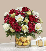 The stylish and extravagant luxury of our Christmas bouquet is sure to leave a lasting impression. Artfully crafted from elegant white roses, rich burgundy dianthus & carnations and fragrant assorted evergreens, our best selling arrangement is gathered fresh in a classic glass vase filled with shimmering ornament balls. Finished off with gold ribbon, this gift is equally stunning as a centerpiece, thank you gift or winter birthday surprise.