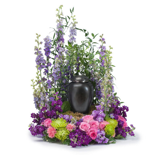 "This tribute combines a beautiful combination of pink and purple flowers that will show that your loved one will be forever cherished.  Approximately 20"" W by 24"" H"