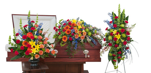 The treasured celebration trio includes a casket spray, standing easel spray and crescent urn arrangement.  Includes items TMF-786 Casket Spray, TMF-787 Urn arrangement, TMF-786 Standing Spray.
