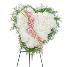 "A sweet white heart of white carnations with roses to symbolize the tears you shed over the loss of your loved one.  Approximately 13 "" (W) x 13""(H)"
