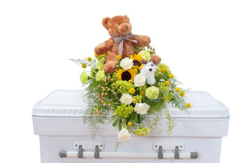 """This sweet combination of flowers and a stuffed bear is perfect for a tiny angel.  Approximately 18 """" (W) x 22""""(H)"""