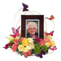 "Butterflies surround the photo of your loved one as a sign of hope and love. Approximately 16"" in diameter"