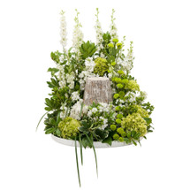 Cream and green blooms in a circular design to surround the urn of your loved one.