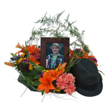 "Lilies and a variety of bright color blooms add to the personalization of a wildflower look.  Approximately 18"" W by 12"" H"