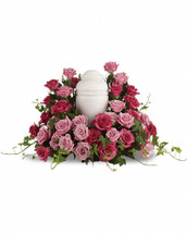 Surrounded by roses, enveloped in love - a sumptuous pink rose wreath of light and dark hues serves as a stunning memorial. Features thirty five light and hot pink roses with trailing stems of lush green ivy.Please note: Arrangement does not include urn