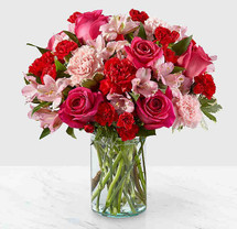 Handcrafted and inspired by the gorgeous hues of the season, the You're Precious™ Bouquet is full of sweet sentiment for your favorite person. Hot pink roses, red carnations, pink alstroemeria, and pale pink carnations come together in a clear glass vase to make any room feel beautiful and light. From special birthdays to simply just because, this arrangement is a stunning gift to give your loved ones for every occasion.
