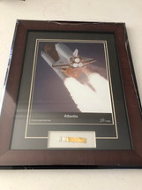 Space Shuttle Atlantis framed photograph - matted to include authentic cargo bay liner