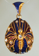 Blue pendant with gold bale