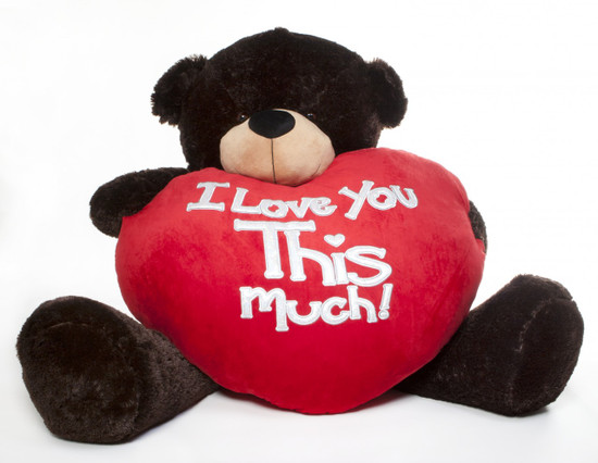 5 foot Brownie Cuddles carries in his arms the largest plush heart you'll ever see!