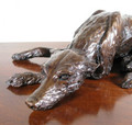 Bronze Sculpture of a Recumbent Lurcher by Clare Ellwood