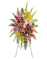 Rays of Light easel spray by Teleflora