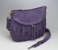 Chrome accents and beautiful drum dyed leather give this concealed carry bag distinction