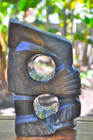 Shona Sculpture 'Sitting Alone' by David Chikuzeni. Sculpted from fruit serpentine stone.