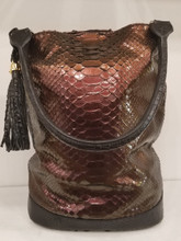 Burgundy metallic Python and black American alligator bucket bag
