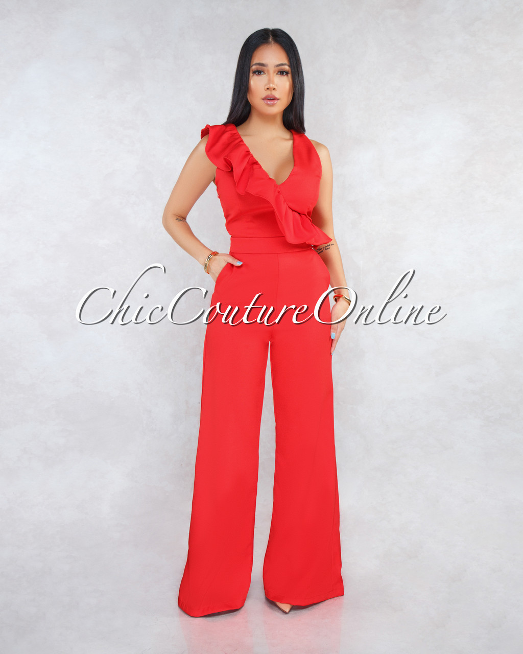 d3a6a96d2cd Dylana Red V-Neck Ruffle Jumpsuit. Price   55.00. Image 1