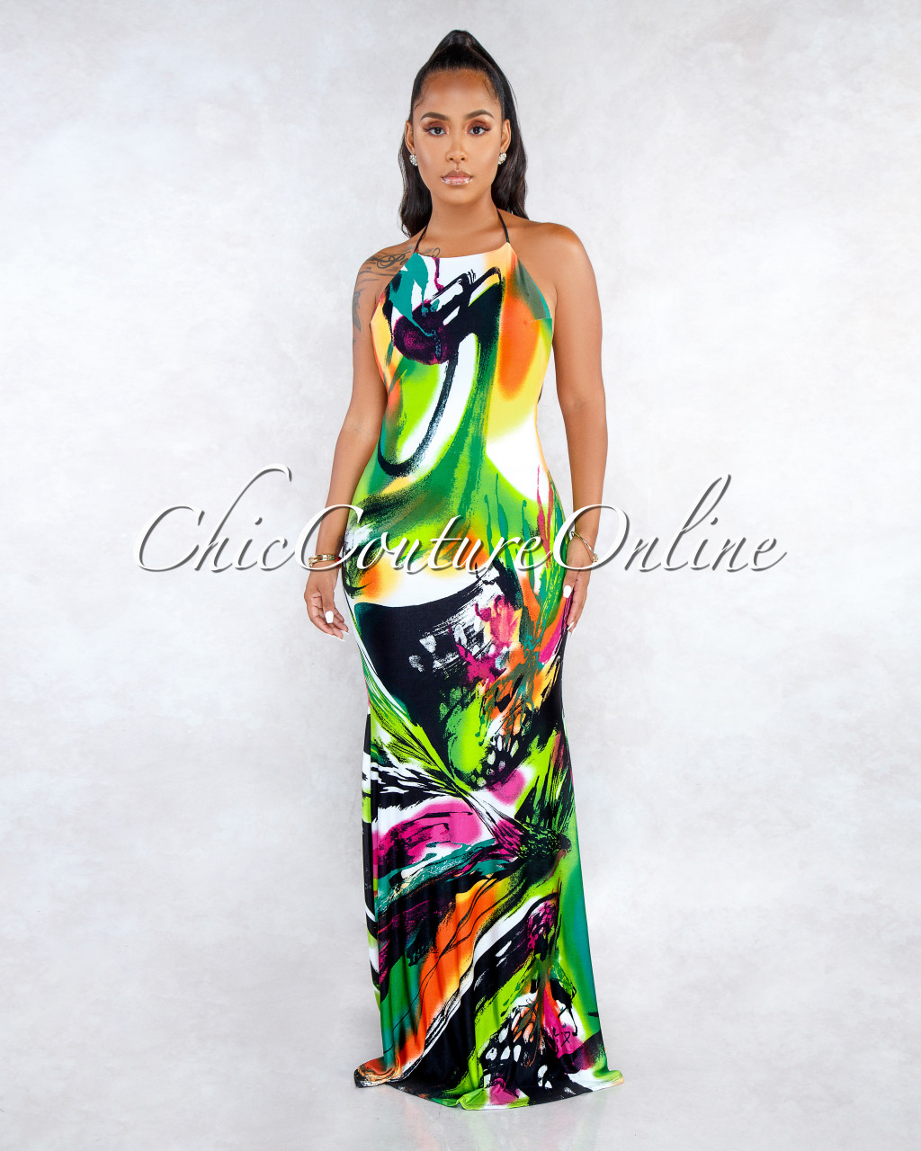 f46ce8d997 Sandie Green Multi-Color Print Halter Low Back Maxi Dress. Price   65.00.  Image 1