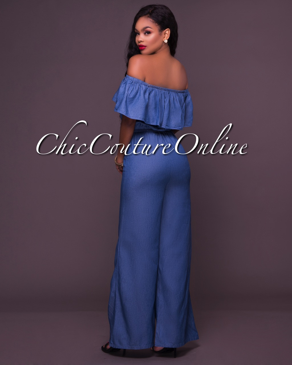 580fb190ed5 Cameron Denim Off-The-Shoulder Ruffle Jumpsuit. Price   48.00. Image 1.  Larger   More Photos