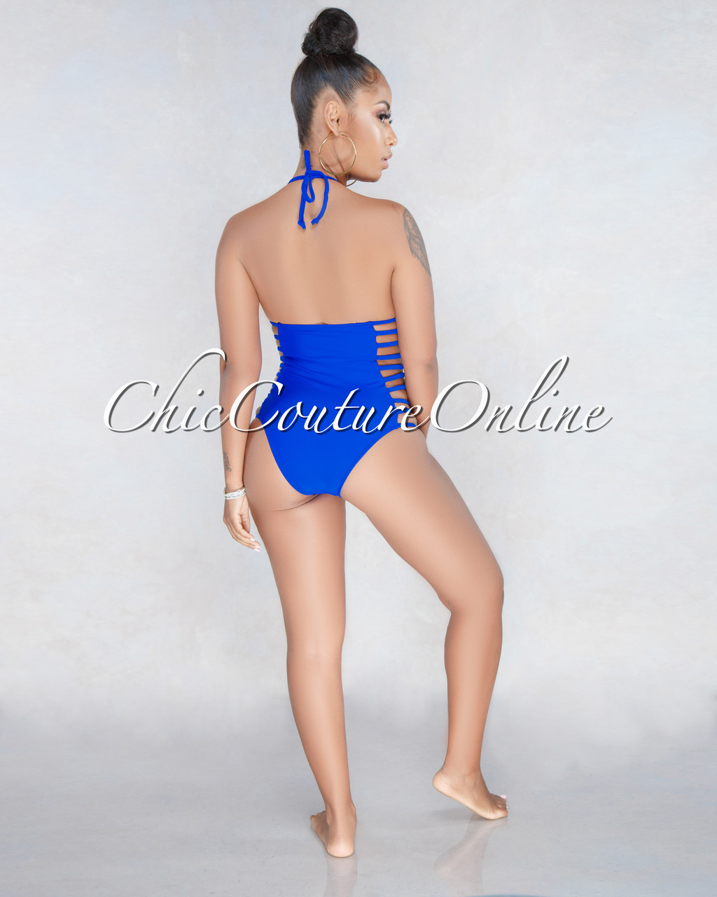 d14daf85e0 Cressida Blue Halter Cut Out Strappy One Piece Swimsuit. Price: $50.00.  Image 1. Larger / More Photos