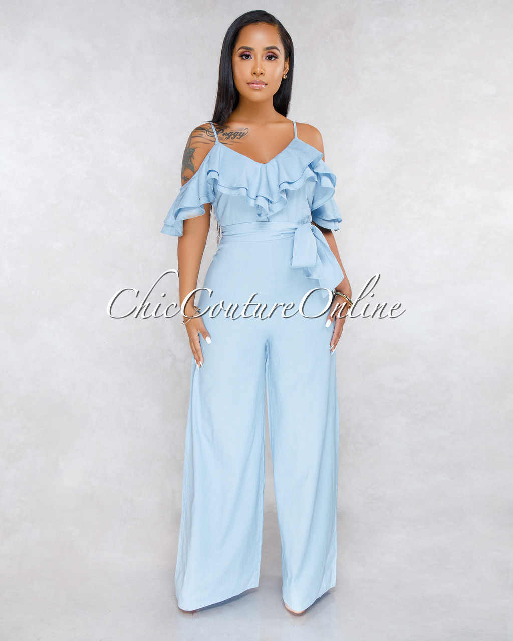 6d48da406db8 Mejeane Light Chambray Ruffle Cold Shoulder Jumpsuit. Price   50.00. Image 1